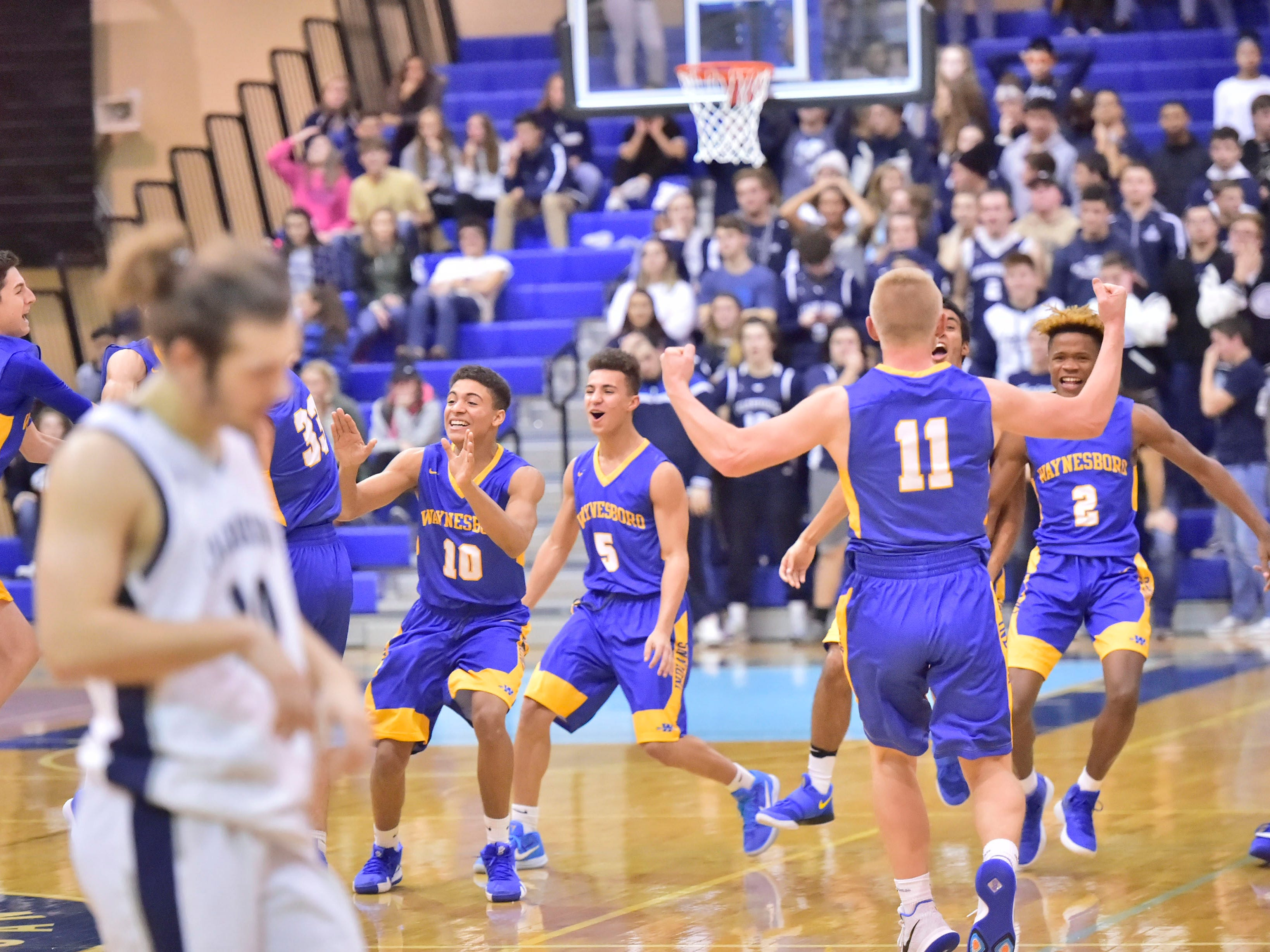 Waynesboro teammates celebrate after defeating Chambersburg 42-39. Chambersburg played Waynesboro during the finals at Franklin County Tip-Off Tournament, Saturday, Dec. 8, 2018.