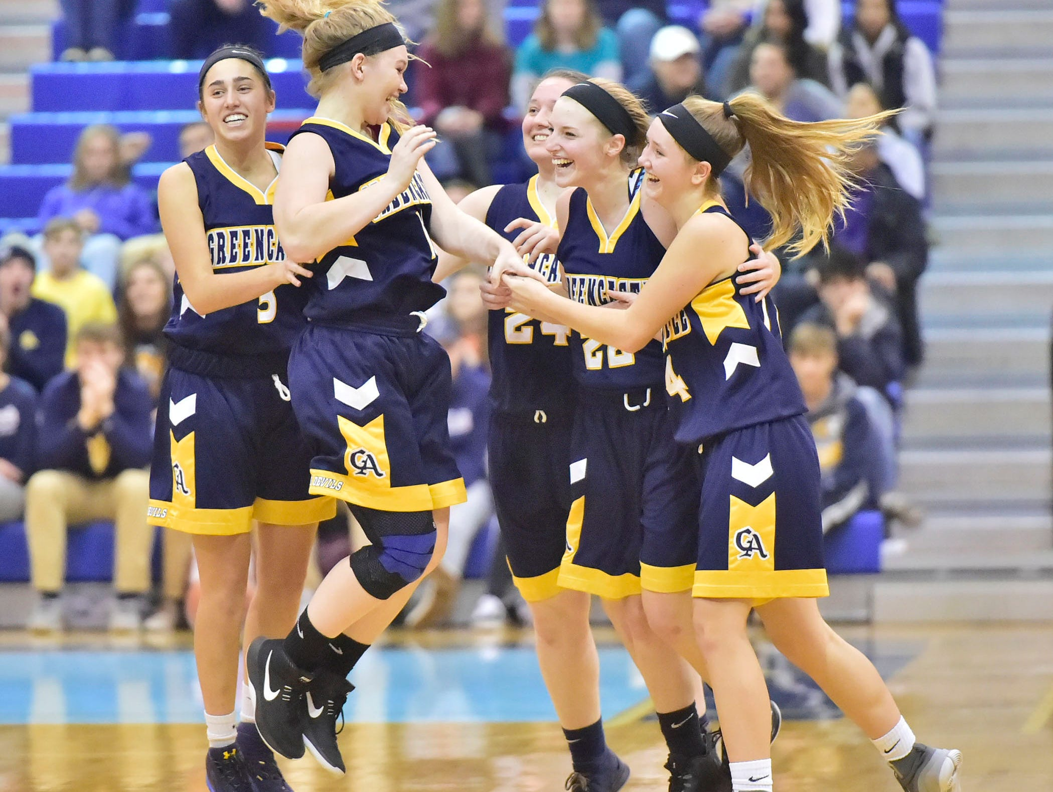 Greencastle teammatres celebrate after a  26-22 win over Chambersburg during the finals at Franklin County Tip-Off Tournament, Saturday, Dec. 8, 2018.