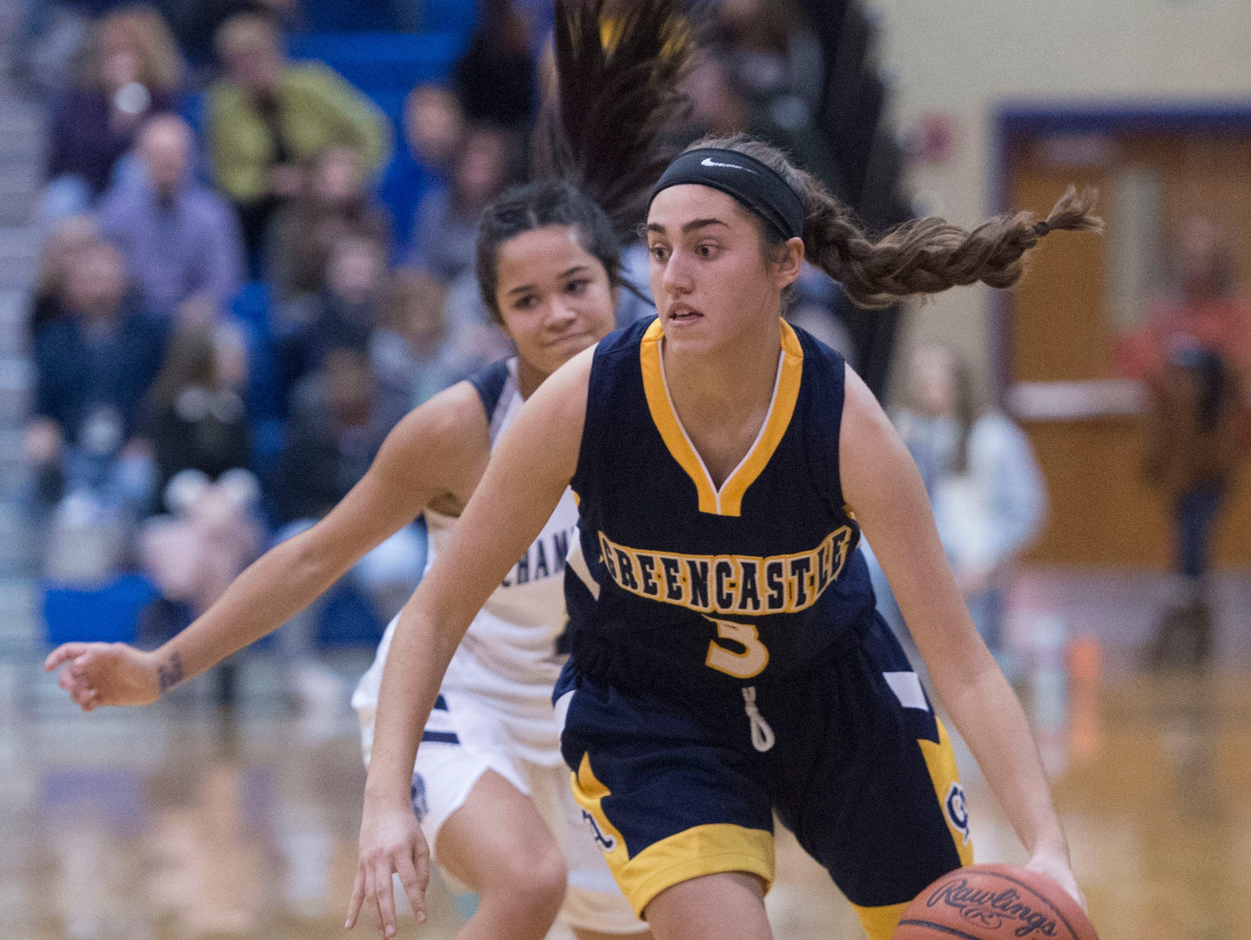 Greencastle's McKenna Rakaczewski (3) dribbles in front of Chambersburg's Erin Patillo. Greencastle defeated Chambersburg 26-22 during the finals at Franklin County Tip-Off Tournament, Saturday, Dec. 8, 2018.