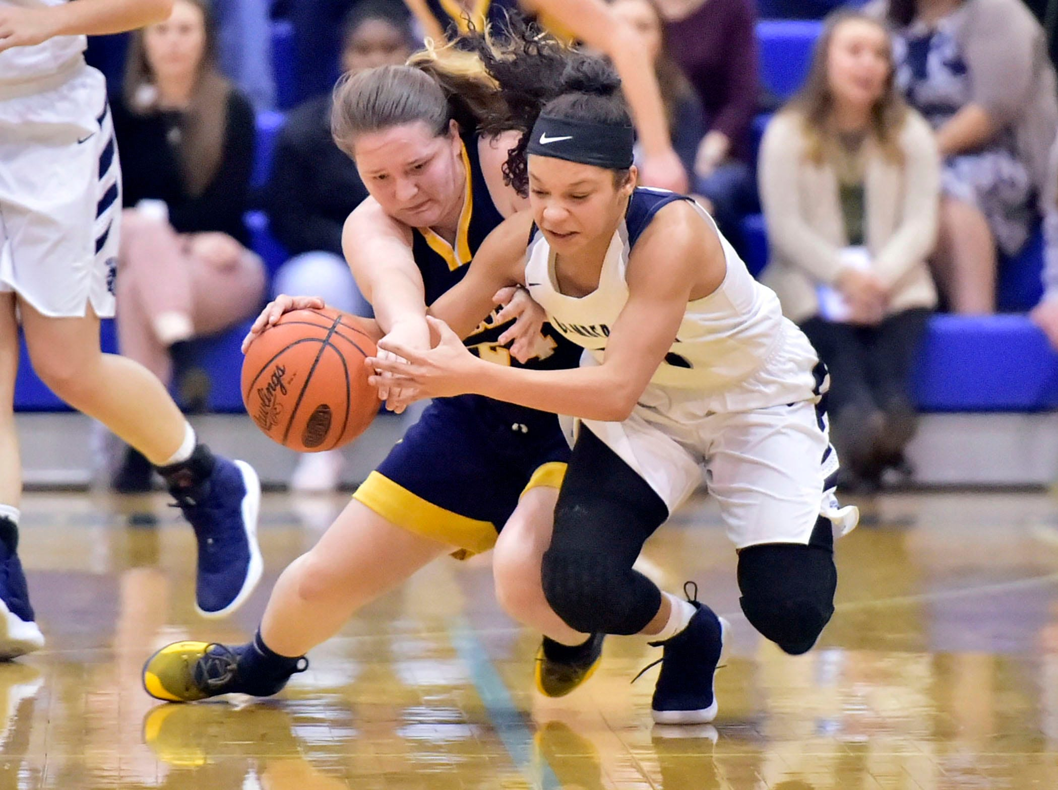 Greencastle's Madison Sweitzer (24) and Chambersburg's Bre'ya Clopper dive for a loose ball.  Greencastle defeated Chambersburg 26-22 during the finals at Franklin County Tip-Off Tournament, Saturday, Dec. 8, 2018.