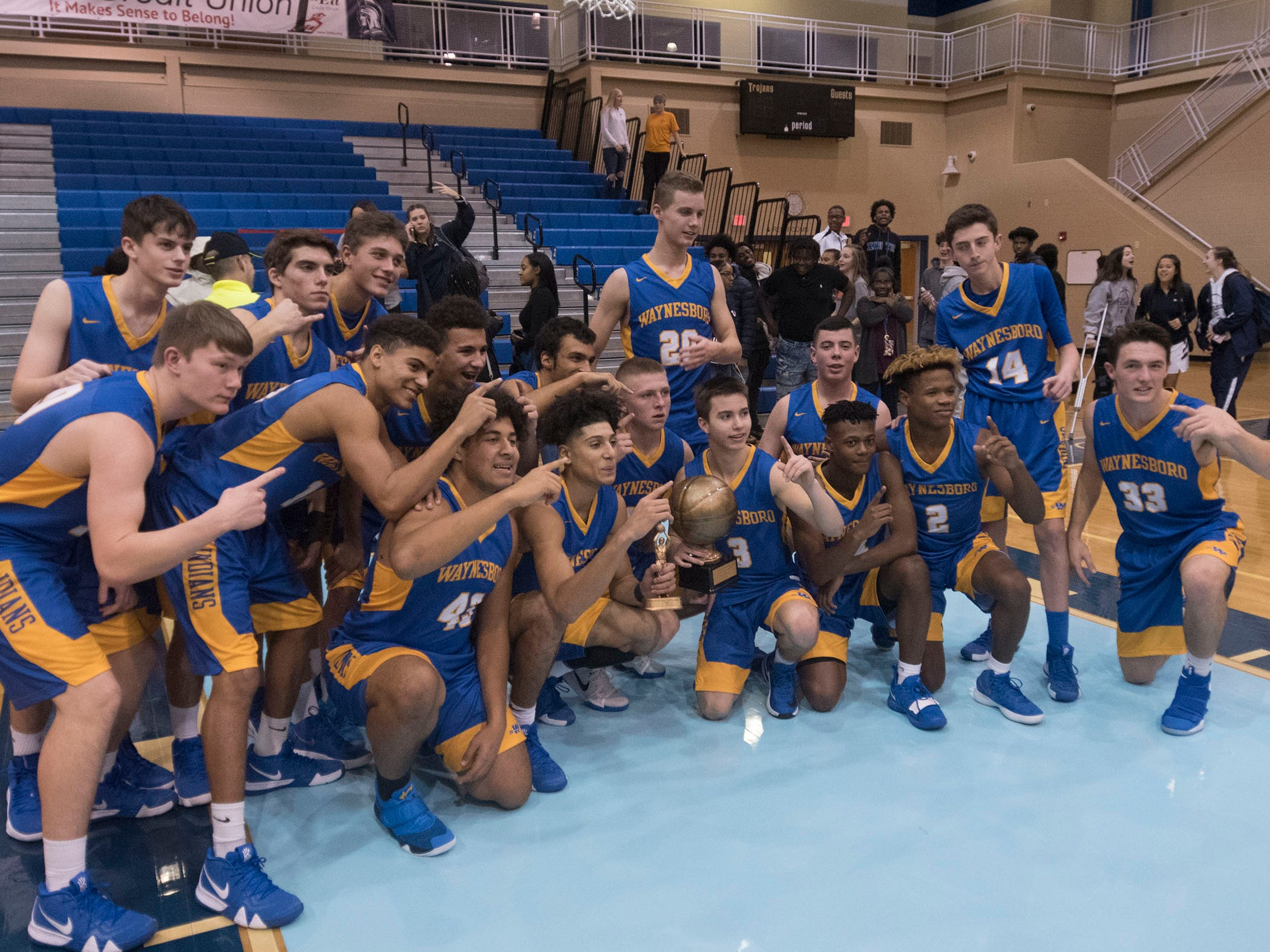 Waynesboro teammates pose for a group shot after defeating Chambersburg 42-39. Chambersburg played Waynesboro during the finals at Franklin County Tip-Off Tournament, Saturday, Dec. 8, 2018.