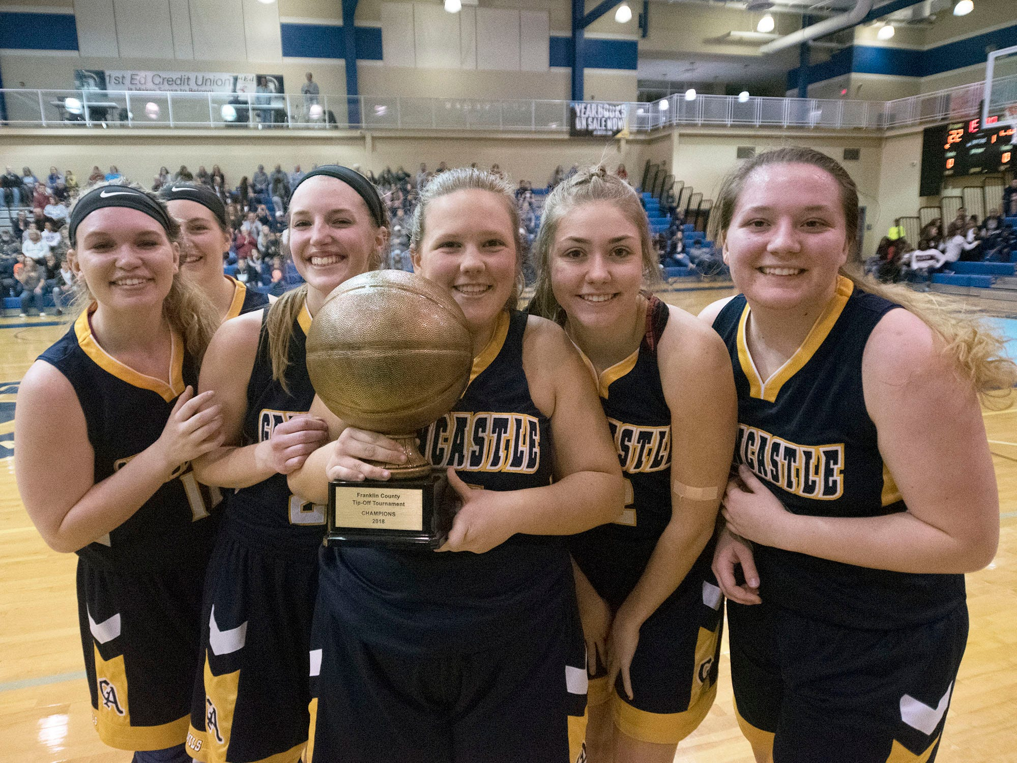 Greencastle celebrates with their tournament trophy. Chambersburg played Greencastle during the finals at Franklin County Tip-Off Tournament, Saturday, Dec. 8, 2018.