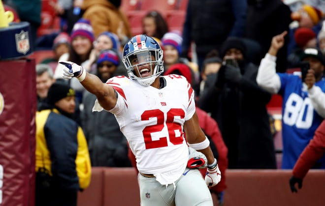 Former Penn State running back Saquon Barkley is seen here celebrating after a touchdown run with the New York Giants. According to PSU head coach James Franklin, Barkley's success has had a positive influence on the Nittany Lions' ability to recruit top-flight running backs. AP FILE PHOTO