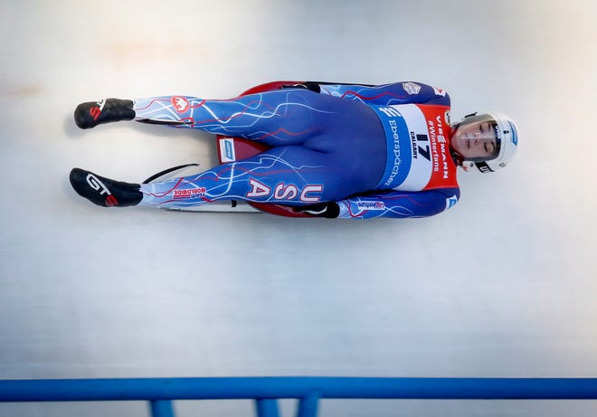 Glen Rock's Summer Britcher races down the track during the women's World Cup luge competition in Calgary, Alberta, Saturday, Dec. 8, 2018. Britcher finished fifth in the event. (Jeff McIntosh/The Canadian Press via AP)