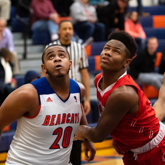 York High's Marquise McClean (20) and Williamsport's Nassir Jones (2) fight for the rebound during the Tip-Off Tournament championship game between York High and Williamsport at York High, Saturday, December 8, 2018. The Bearcats defeated the Millionaires 74-47.
