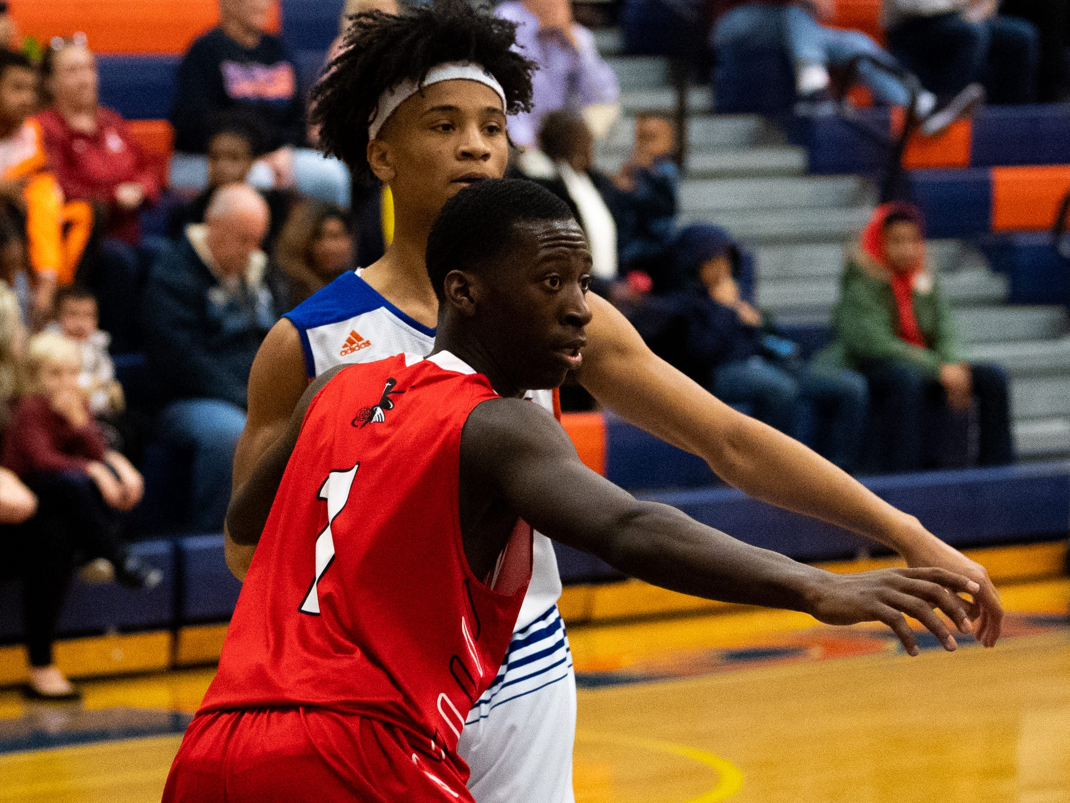 Ahmir Ellzy (1) plays tight defense during the Tip-Off Tournament championship game between York High and Williamsport at York High, Saturday, December 8, 2018. The Bearcats defeated the Millionaires 74-47.