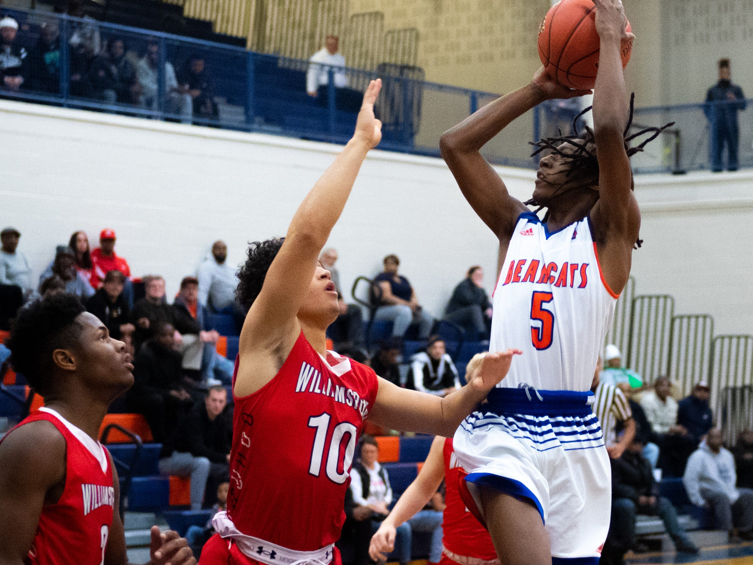 Edward Minter (5) of York High goes up for the shot during the Tip-Off Tournament championship game between York High and Williamsport at York High, Saturday, December 8, 2018. The Bearcats defeated the Millionaires 74-47.