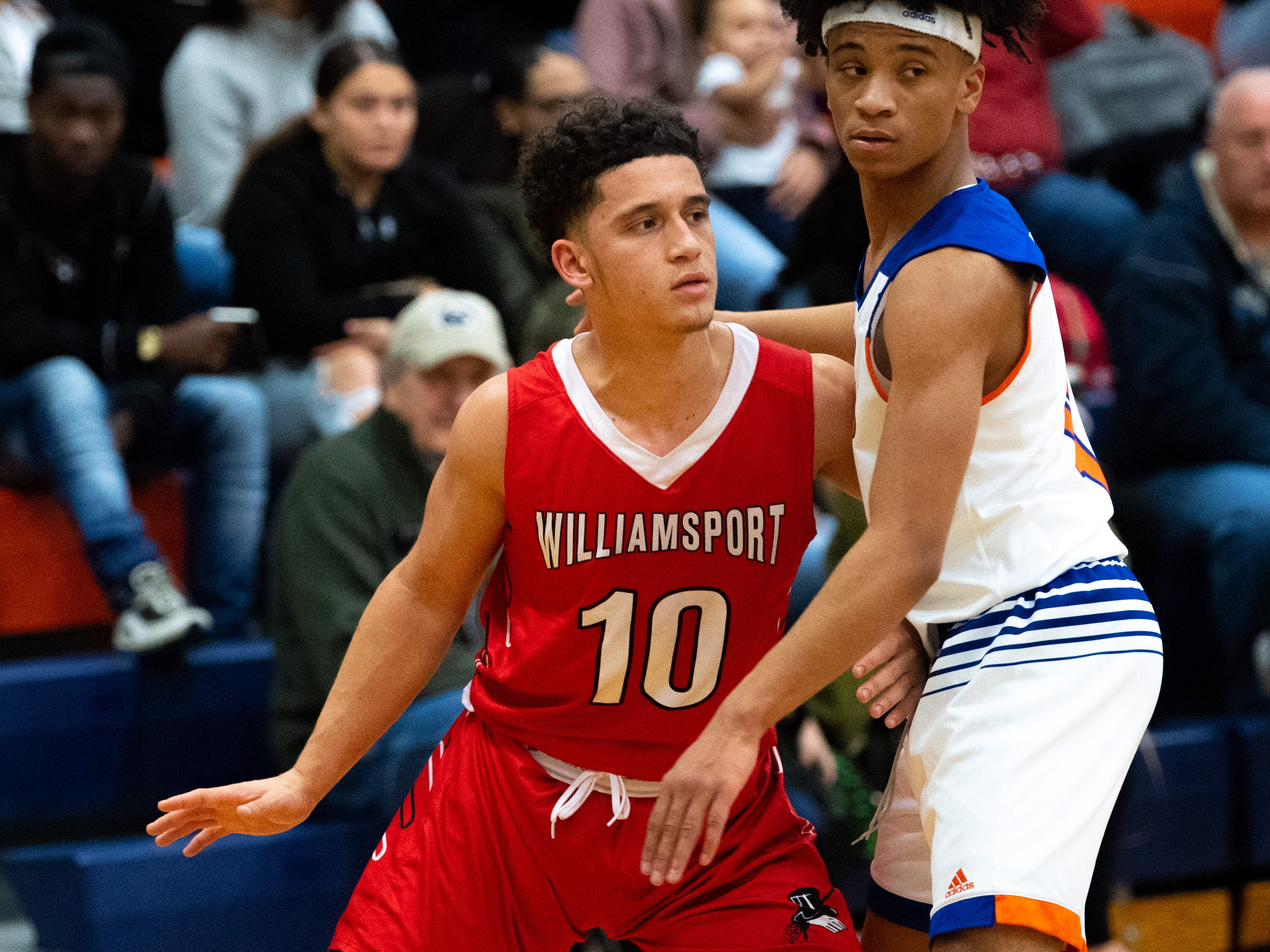 Marcus Simmons (10) of Williamsport tries to get open during the Tip-Off Tournament championship game, Saturday, December 8, 2018. The Bearcats defeated the Millionaires 74-47.