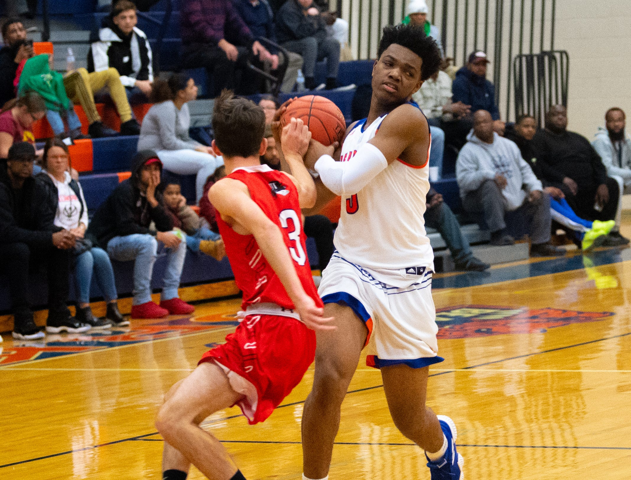 Clovis Gallon Jr. (3) keeps control of the ball during the Tip-Off Tournament championship game between York High and Williamsport at York High, Saturday, December 8, 2018. The Bearcats defeated the Millionaires 74-47.