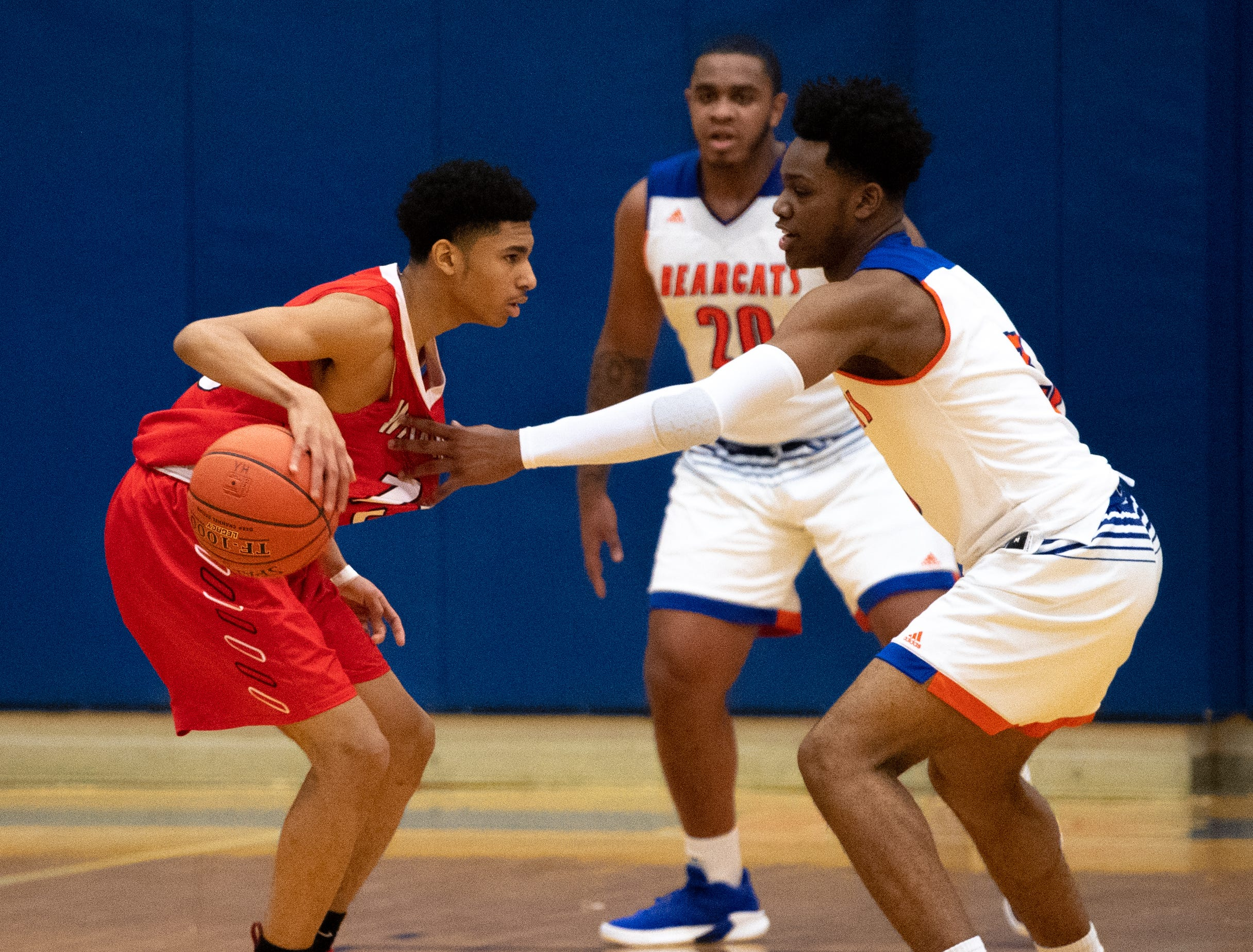 Clovis Gallon Jr. (3) of York High guards Ethan Williams (13) of Williamsport during the Tip-Off Tournament championship game, Saturday, December 8, 2018. The Bearcats defeated the Millionaires 74-47.