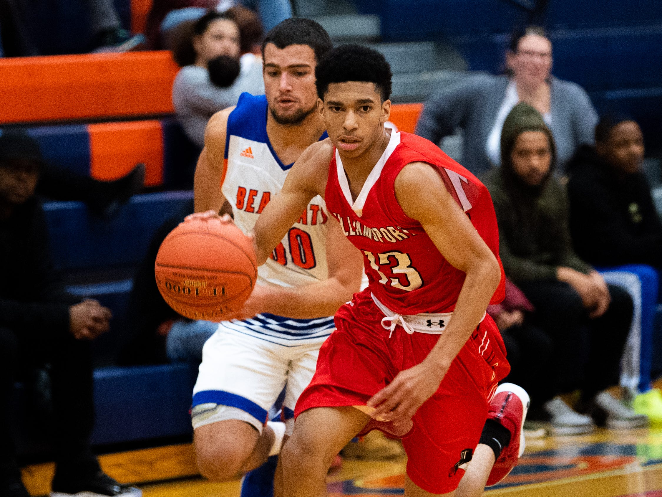 Ethan Williams (13) leads the fast break during the Tip-Off Tournament championship game between York High and Williamsport at York High, Saturday, December 8, 2018. The Bearcats defeated the Millionaires 74-47.