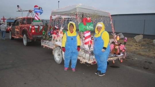 Minions prepare to ride in the annual parade.