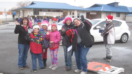 People prepare for Yerington's annual parade of lights Saturday.