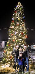 (From left) Parker O'Brien, 17, Kelsye Cates, Mason Cates, 6, and Spencer O'Brien have their photo taken in front of Fernley's Christmas tree.