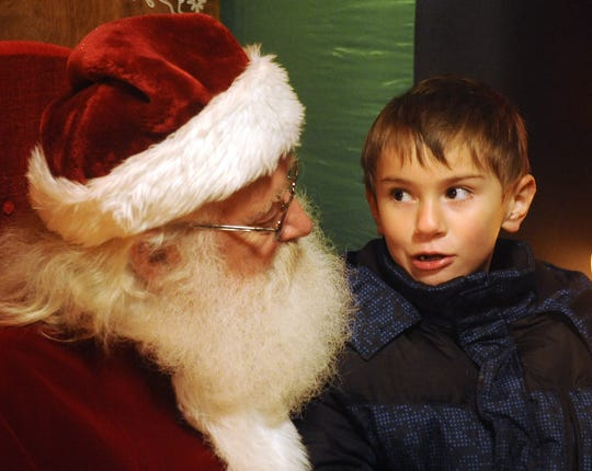 Lucas Trupower, 6, tells Santa what he wants for Christmas.