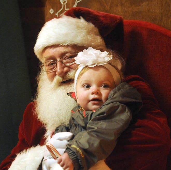 Ara Burkett, nine months, of Silver Springs, has her photo taken with Santa.