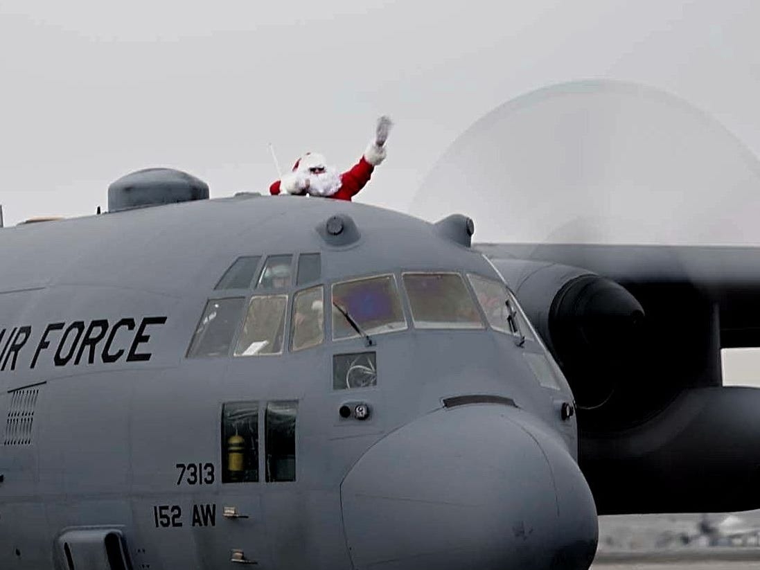 Santa Claus pokes his head out of a military plane as he lands on Dec. 8, 2018 at Atlantic Aviation for Operation Santa Claus, a charity event that helps families in need in Reno-Sparks. The event is organized by The Children's Cabinet, among other nonprofit agencies.