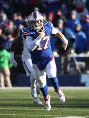 Bills quarterback Josh Allen tucks the ball and runs for some of his 101 rushing yards.