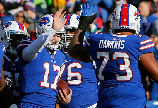 Ex-Bill Eric Wood believes Dion Dawkins (73) has the talent to continue playing left tackle for Buffalo.