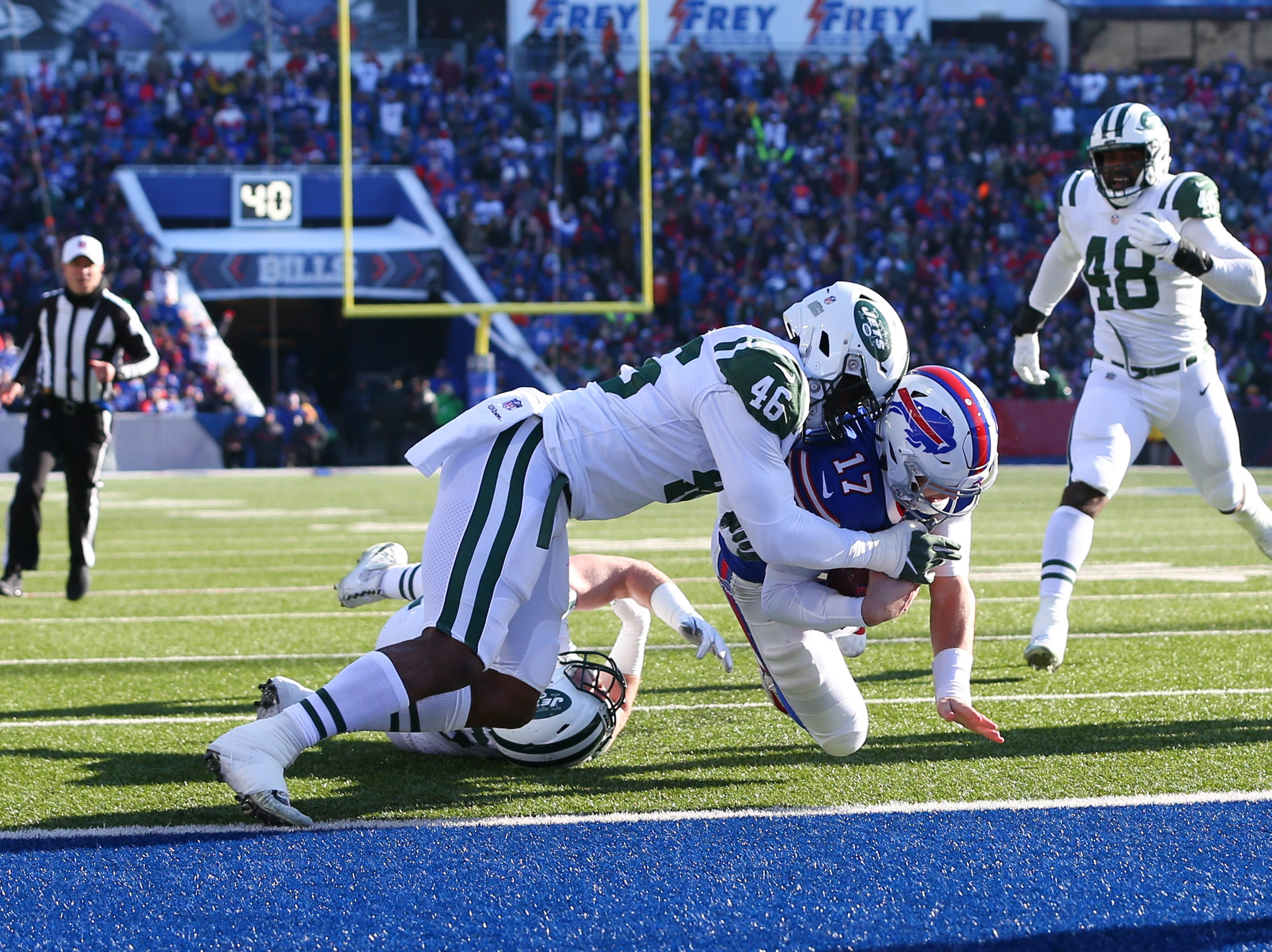 Dec 9, 2018; Orchard Park, NY, USA; Buffalo Bills quarterback Josh Allen (17) dives into the end zone for a touchdown as New York Jets linebacker Neville Hewitt (46) defends during the first quarter at New Era Field. Mandatory Credit: Rich Barnes-USA TODAY Sports