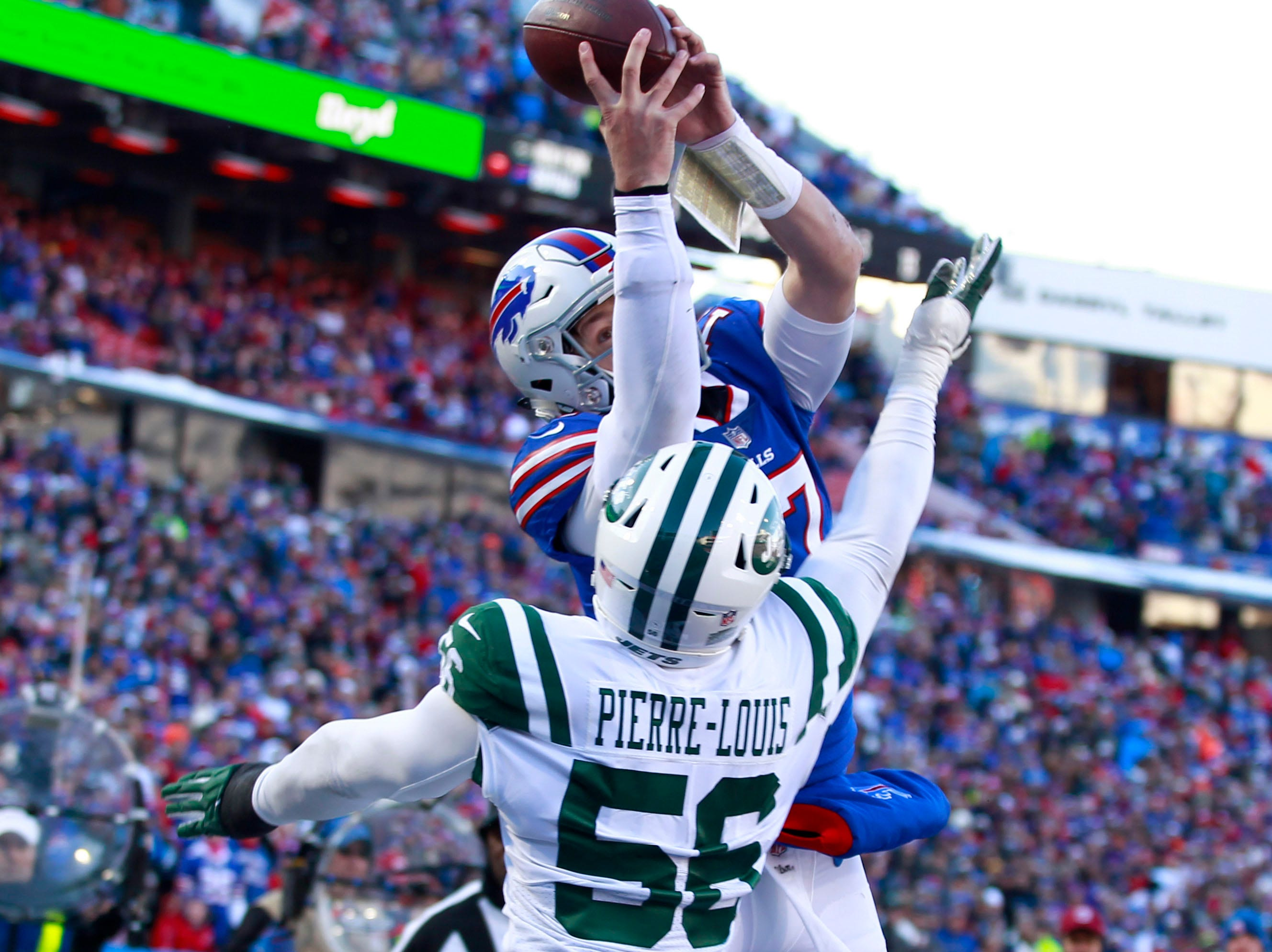 Dec 9, 2018; Orchard Park, NY, USA; Buffalo Bills quarterback Josh Allen (17) tries to catch a pass as New York Jets linebacker Kevin Pierre-Louis (56) tries to block it during the first half at New Era Field. Mandatory Credit: Timothy T. Ludwig-USA TODAY Sports