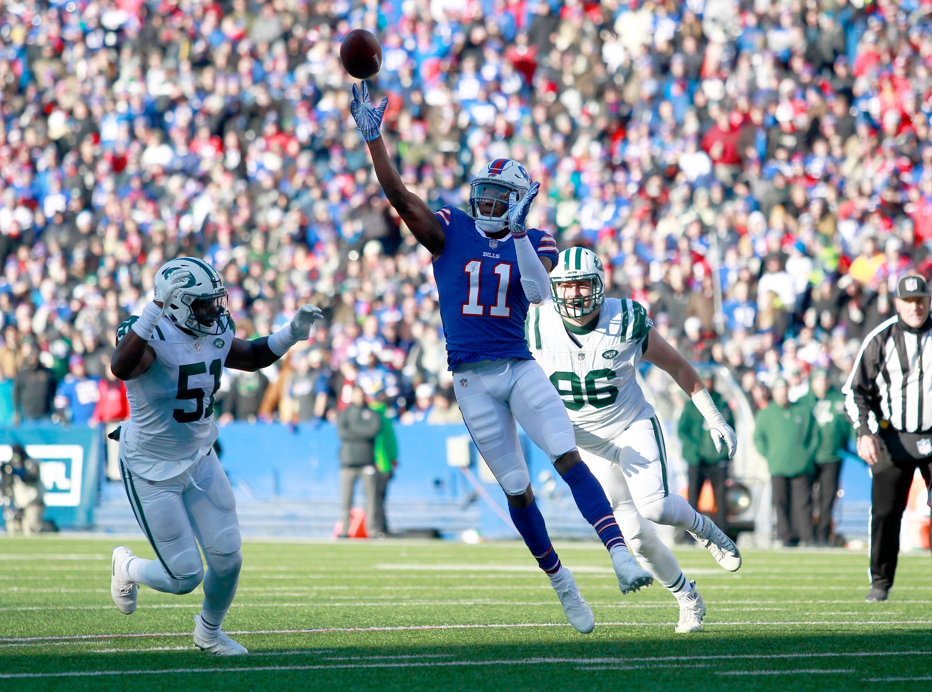 Dec 9, 2018; Orchard Park, NY, USA; Buffalo Bills wide receiver Zay Jones (11) throws a pass during the first half against the New York Jets at New Era Field. Mandatory Credit: Timothy T. Ludwig-USA TODAY Sports