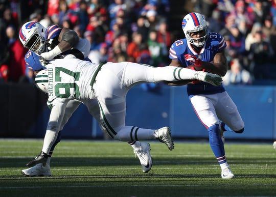 Bills running back Chris Ivory fights through Jets Nathan Shepherd for short gain.