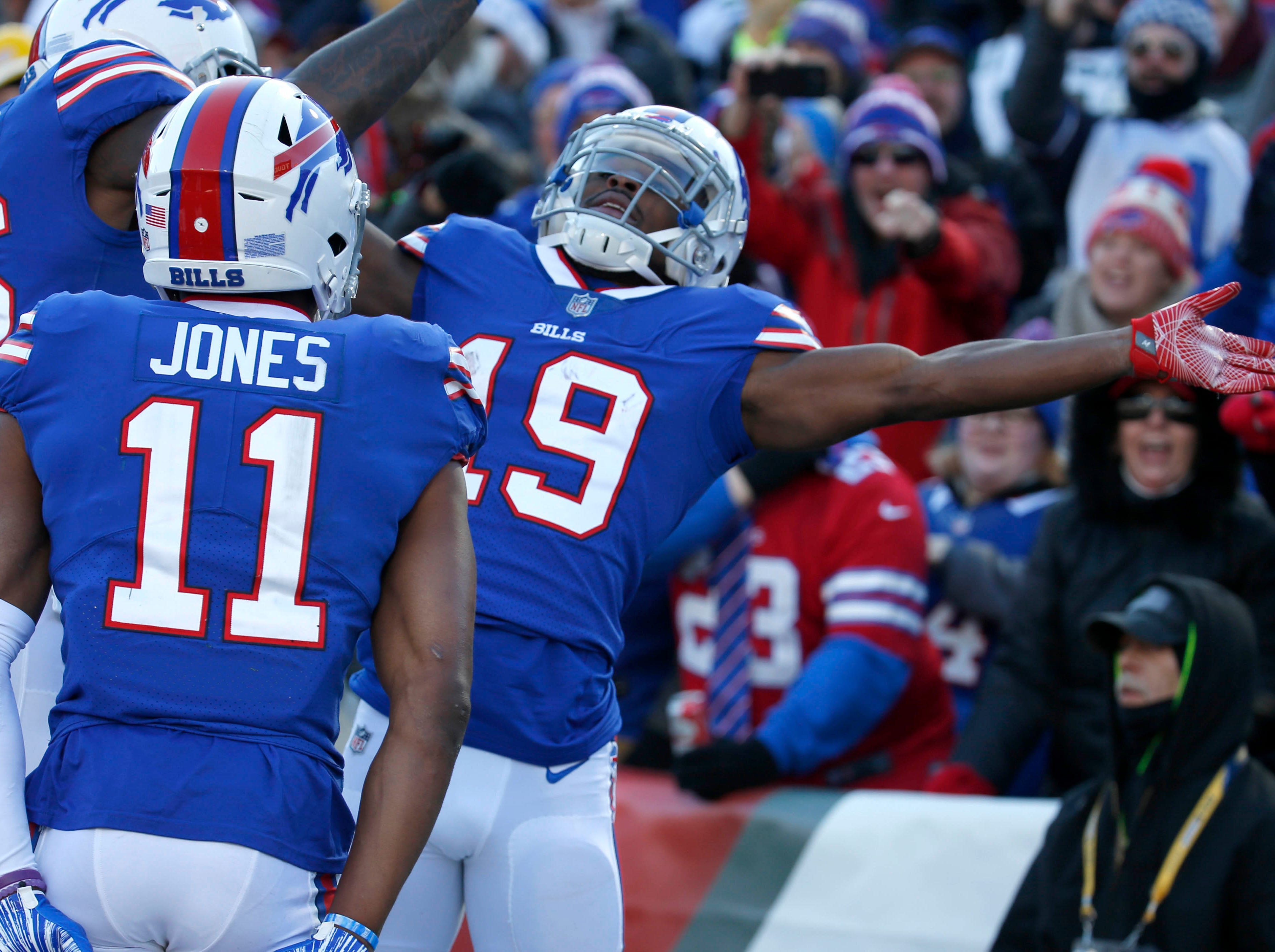 Dec 9, 2018; Orchard Park, NY, USA; Buffalo Bills wide receiver Isaiah McKenzie (19) celebrates his touchdown with wide receiver Robert Foster (16) and wide receiver Zay Jones (11) during the first half against the New York Jets at New Era Field. Mandatory Credit: Timothy T. Ludwig-USA TODAY Sports