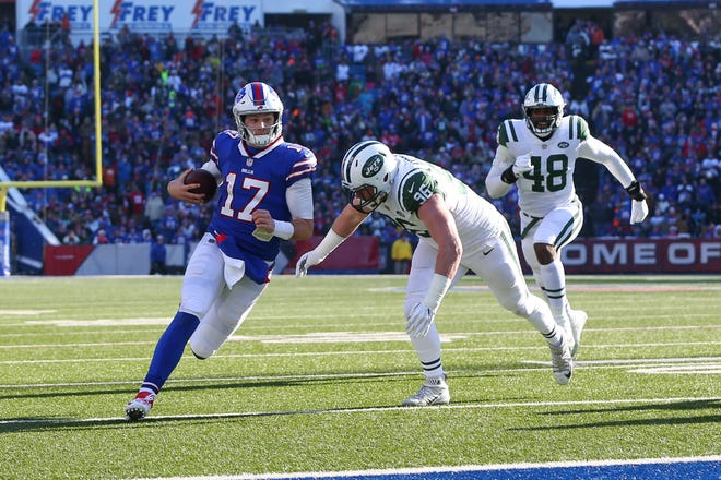 Dec 9, 2018; Orchard Park, NY, USA; Buffalo Bills quarterback Josh Allen (17) runs with the ball as New York Jets defensive end Henry Anderson (96) defends during the first quarter at New Era Field. Mandatory Credit: Rich Barnes-USA TODAY Sports