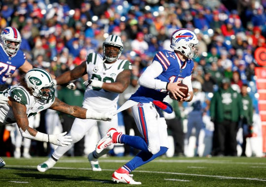 Dec 9, 2018; Orchard Park, NY, USA; New York Jets defensive end Leonard Williams (92) grabs the shirts of Buffalo Bills quarterback Josh Allen (17) as he runs the ball during the first half at New Era Field. Mandatory Credit: Timothy T. Ludwig-USA TODAY Sports
