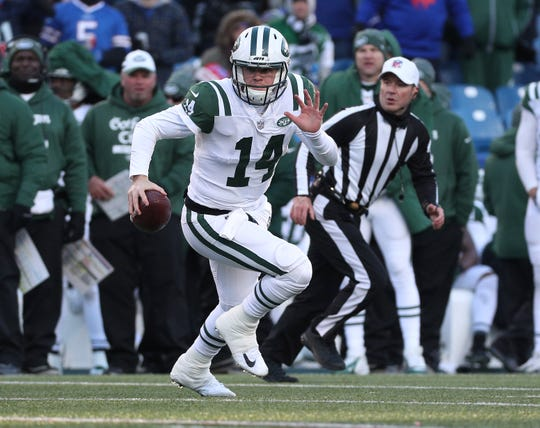 Jets rookie quarterback Sam Darnold scrambles against the Bills. He passed for 170 yards and a touchdown in a 27-23 win over the Bills.
