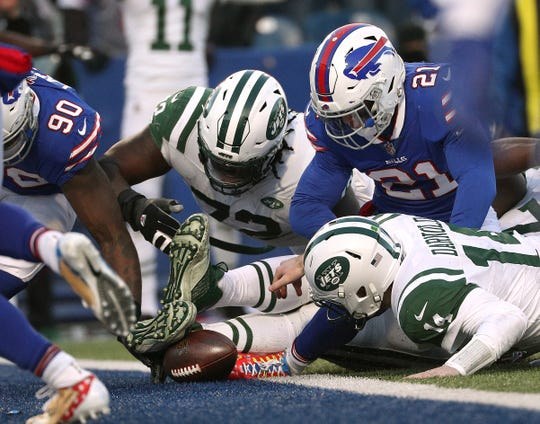 Jets quarterback Sam Darnold was ruled  down before losing the ball near the goalie against the Bills.