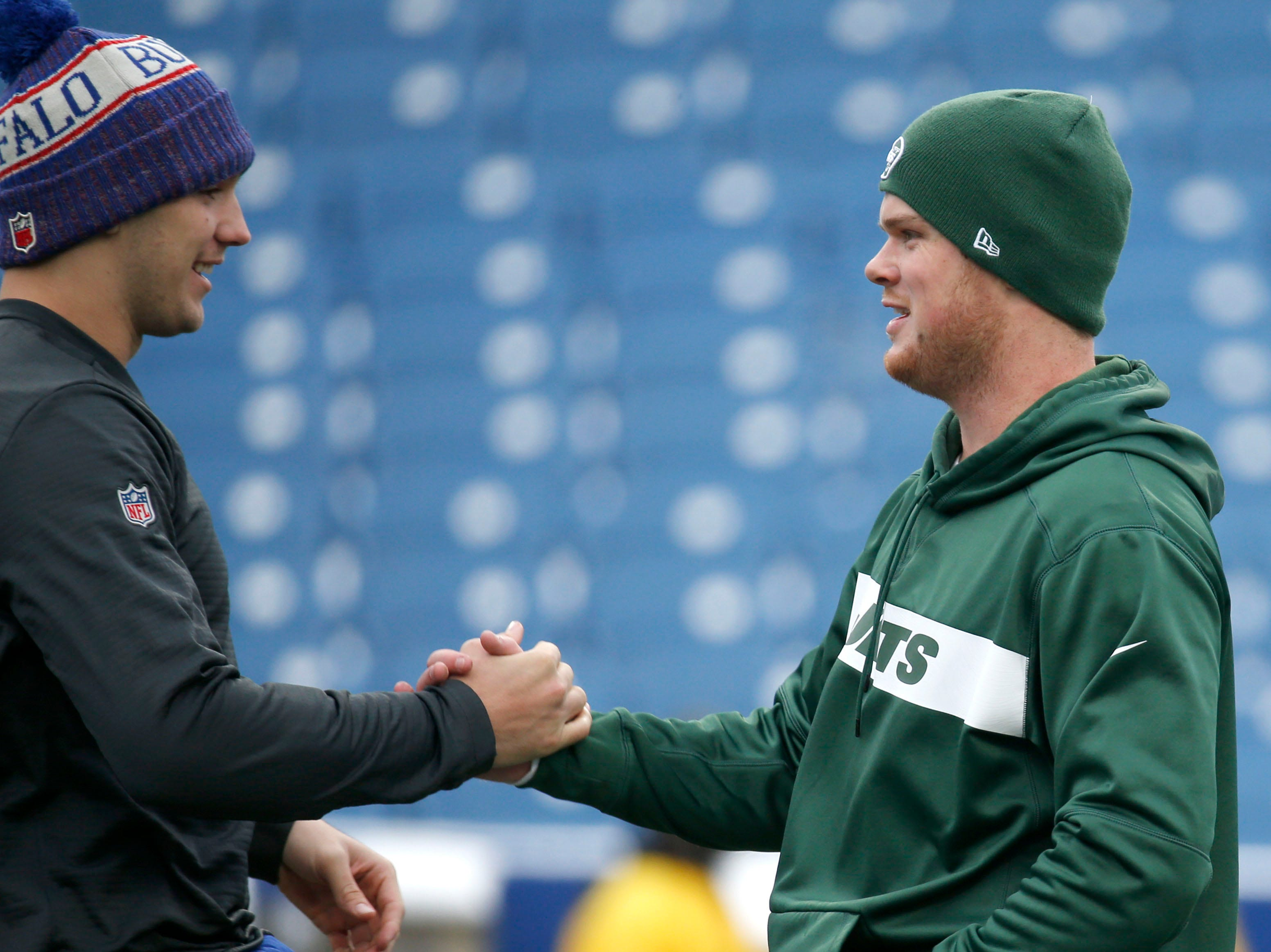 Dec 9, 2018; Orchard Park, NY, USA; Buffalo Bills quarterback Josh Allen (17) and New York Jets quarterback Sam Darnold (14) on the field before a game at New Era Field. Mandatory Credit: Timothy T. Ludwig-USA TODAY Sports
