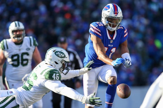 Dec 9, 2018; Orchard Park, NY, USA; Buffalo Bills wide receiver Zay Jones (11) drops a pass as New York Jets linebacker Neville Hewitt (46) defends during the second quarter at New Era Field. Mandatory Credit: Rich Barnes-USA TODAY Sports