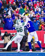 ORCHARD PARK, NY - DECEMBER 09:  Kevin Pierre-Louis #56 of the New York Jets breaks up a pass intended for Josh Allen #17 of the Buffalo Bills in the end zone thrown by Zay Jones #11 during the second quarter at New Era Field on December 9, 2018 in Orchard Park, New York.  (Photo by Brett Carlsen/Getty Images)