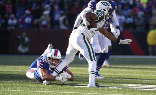 Bills linebacker Matt Milano stops Jets running back Trenton Cannon.