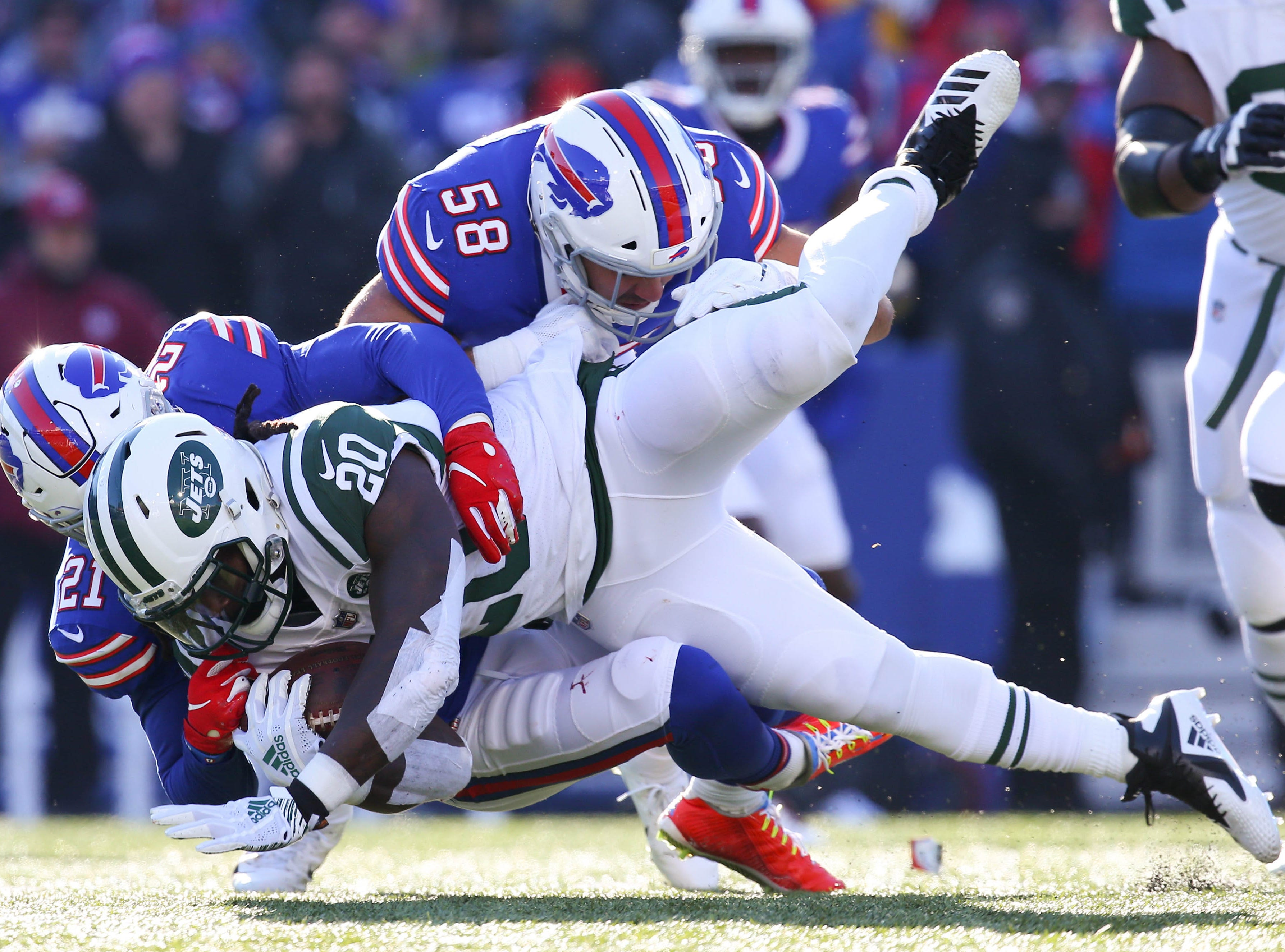 Dec 9, 2018; Orchard Park, NY, USA; Buffalo Bills free safety Jordan Poyer (21) and outside linebacker Matt Milano (58) combine to tackle New York Jets running back Isaiah Crowell (20) on a run during the first quarter at New Era Field. Mandatory Credit: Rich Barnes-USA TODAY Sports