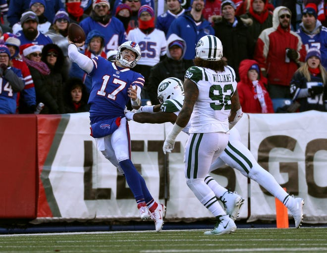 Bills quarterback Josh Allen makes an off balance throw downfield in a 27-23 loss to the Jets.