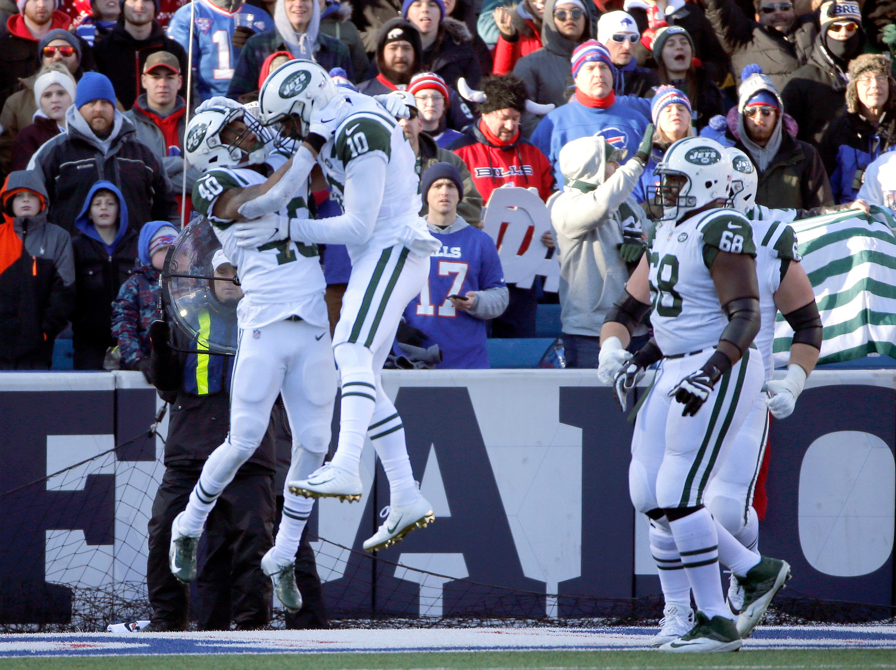 New York Jets running back Trenton Cannon (40) celebrates his touchdown run against the Buffalo Bills with Jermaine Kearse (10) during the first half of an NFL football game, Sunday, Dec. 9, 2018, in Orchard Park, N.Y. (AP Photo/Jeffrey T. Barnes)