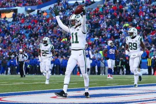 Dec 9, 2018; Orchard Park, NY, USA; New York Jets wide receiver Robby Anderson (11) reacts to his touchdown catch against the Buffalo Bills during the fourth quarter at New Era Field. Mandatory Credit: Rich Barnes-USA TODAY Sports