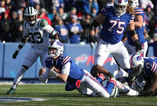 Bills quarterback Josh Allen lunges forward as he is tackle after one of his nine carries.