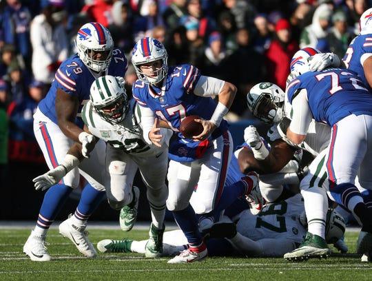The pocket collapses around Bills quarterback Josh Allen.