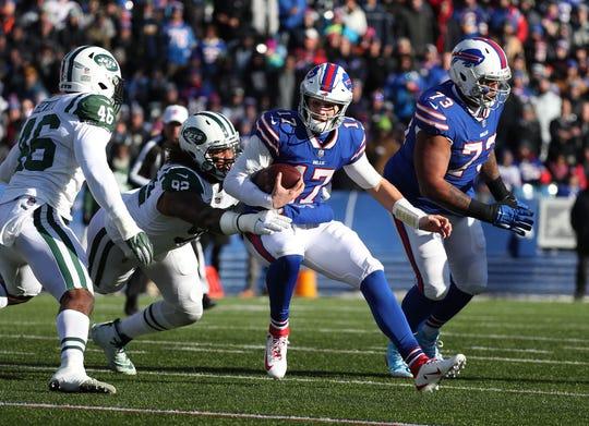Bills quarterback Josh Allen is tackled by Jets Leonard Williams.