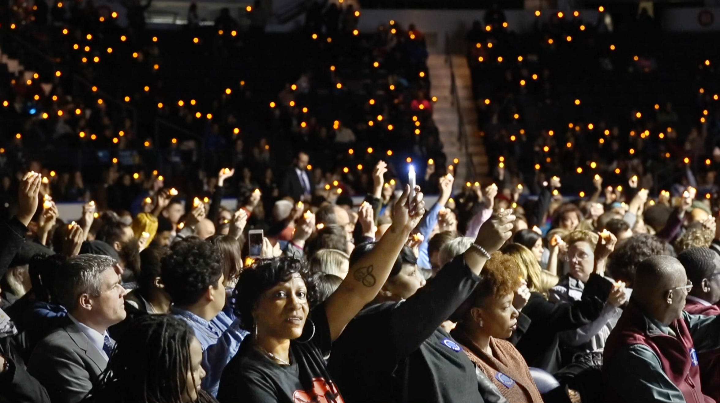 Hundreds of people raise LED candles in a show of support and love for Trevyan Rowe during a vigil held for the 14-year-old at the Blue Cross Arena at the War Memorial.