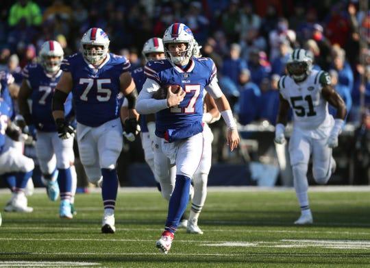 Bills quarterback Josh Allen ran nine times gaining 101 yards and scoring a touchdown against the Jets.