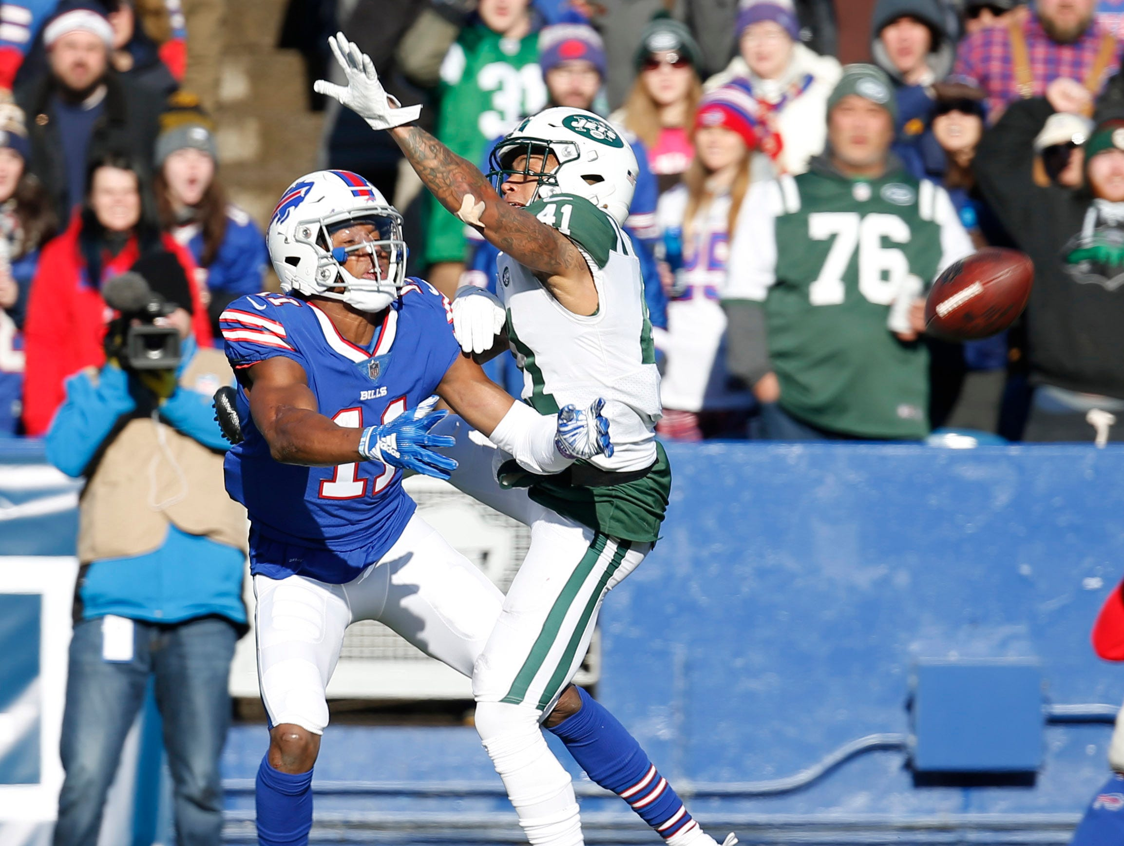 Dec 9, 2018; Orchard Park, NY, USA; Buffalo Bills wide receiver Zay Jones (11) looks to make a catch as he's interfered by New York Jets cornerback Buster Skrine (41) during the first half at New Era Field. Mandatory Credit: Timothy T. Ludwig-USA TODAY Sports