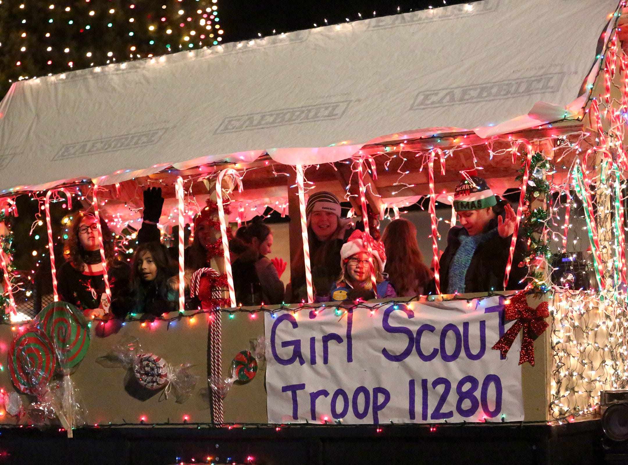 Keizer Girl Scouts on their float during the Keizer Holiday Lights Parade in Keizer on Saturday, Dec. 8, 2018. This year's theme was Christmas in Candyland.