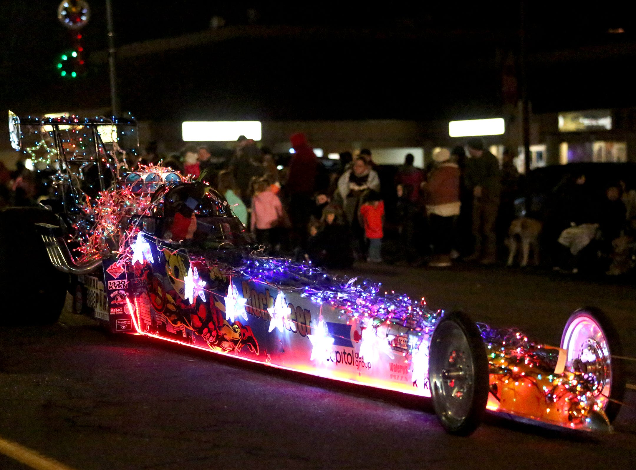 A race car covered in lights is showcased at the Keizer Holiday Lights Parade in Keizer on Saturday, Dec. 8, 2018.