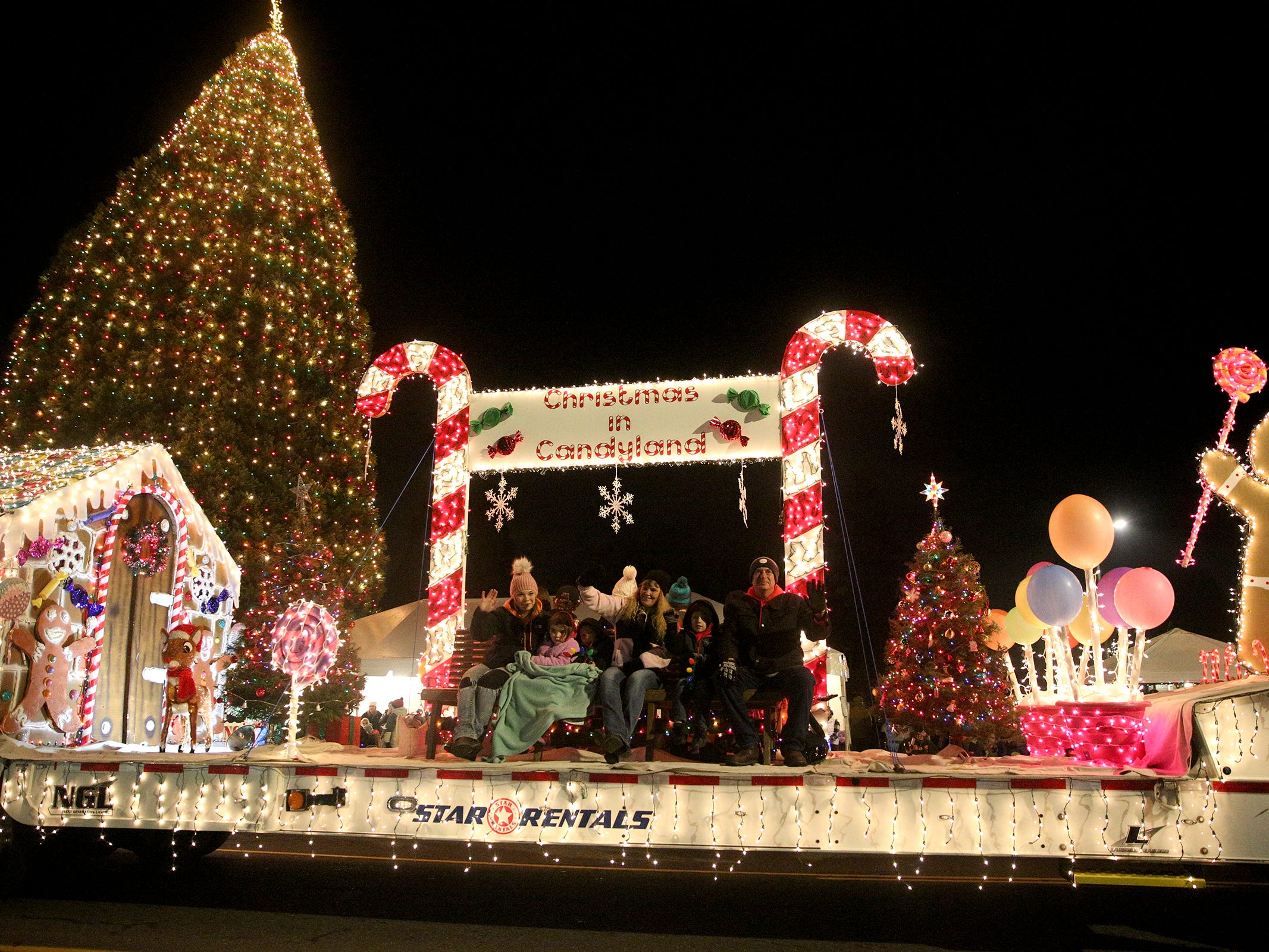 Winners of Best Theme showcase their float during the Keizer Holiday Lights Parade in Keizer on Saturday, Dec. 8, 2018. This year's theme was Christmas in Candyland.