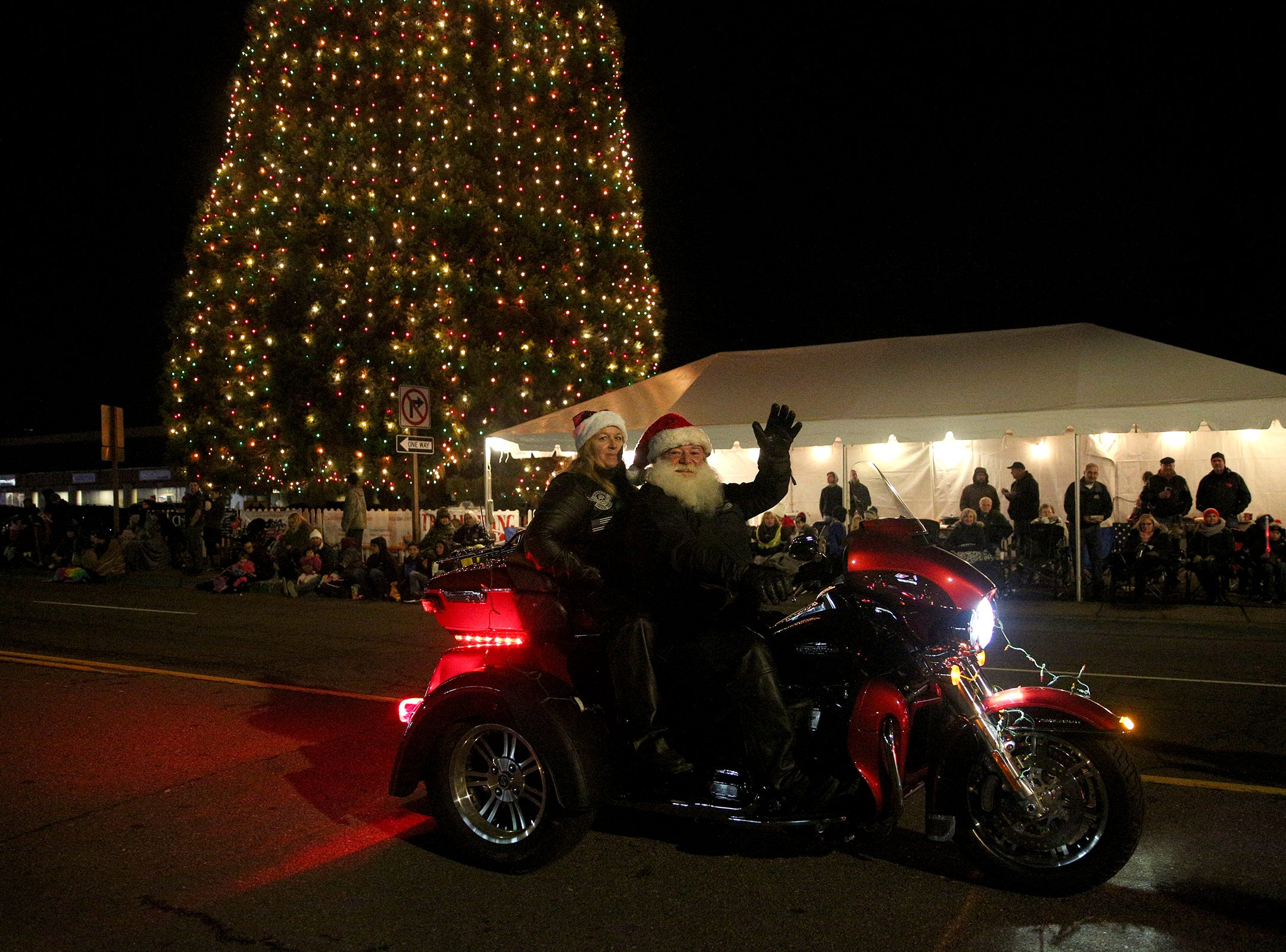 Motorcyclists ride through the Keizer Holiday Lights Parade in Keizer on Saturday, Dec. 8, 2018.
